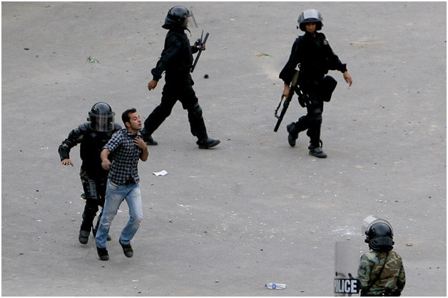 Man Detained by Iranian Riot-Police
