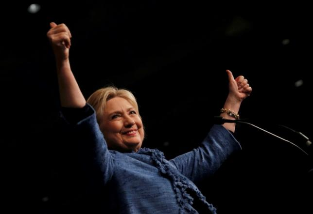 Democratic U.S. presidential candidate Hillary Clinton gives thumbs ups as she speaks to supporters at a campaign rally in West Palm Beach