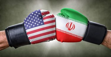 Boxing gloves with US and Iran flags
