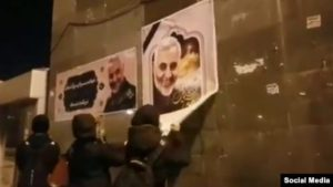 iran-protesters-tear-down-qasem